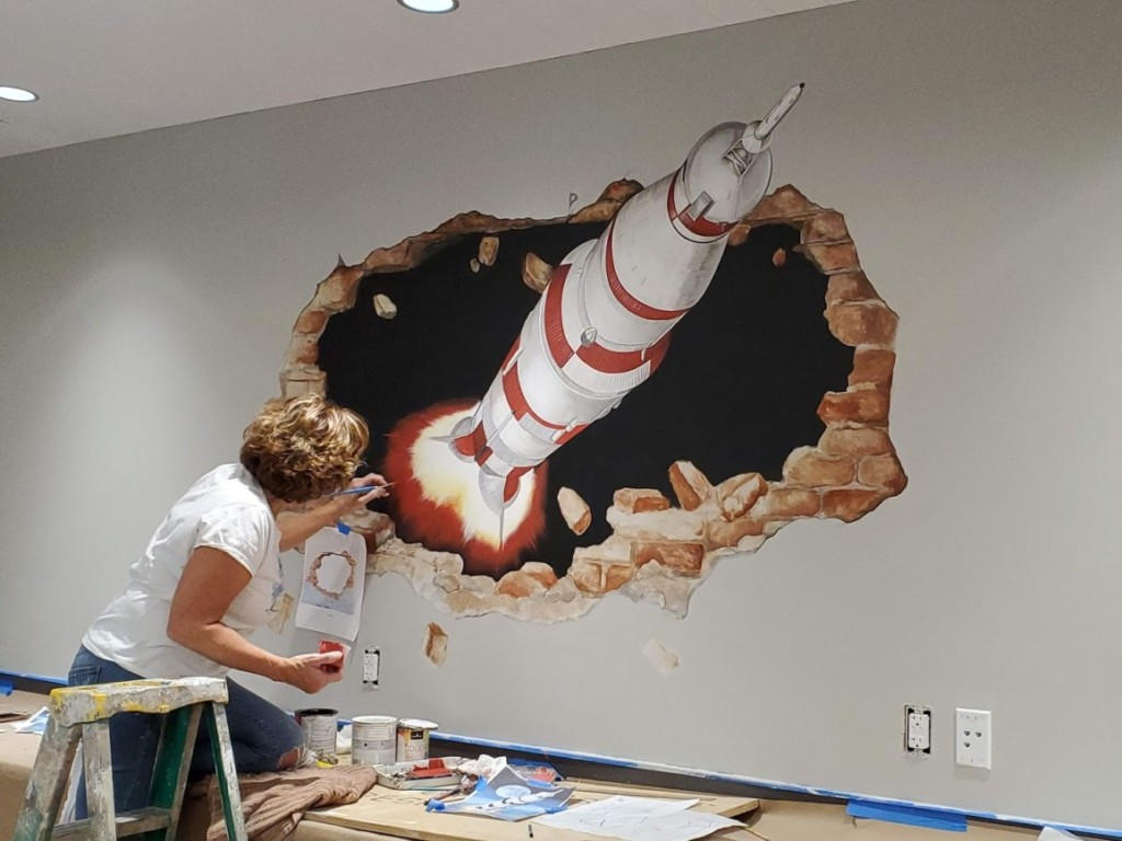 Rocket Cafe Mural being painted