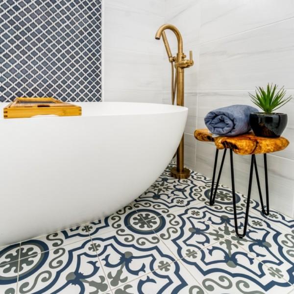 Painted floor tile Freestanding Oversized Tub with Matt Gold fixtures | Distinctive Interior Designs | Collingswood