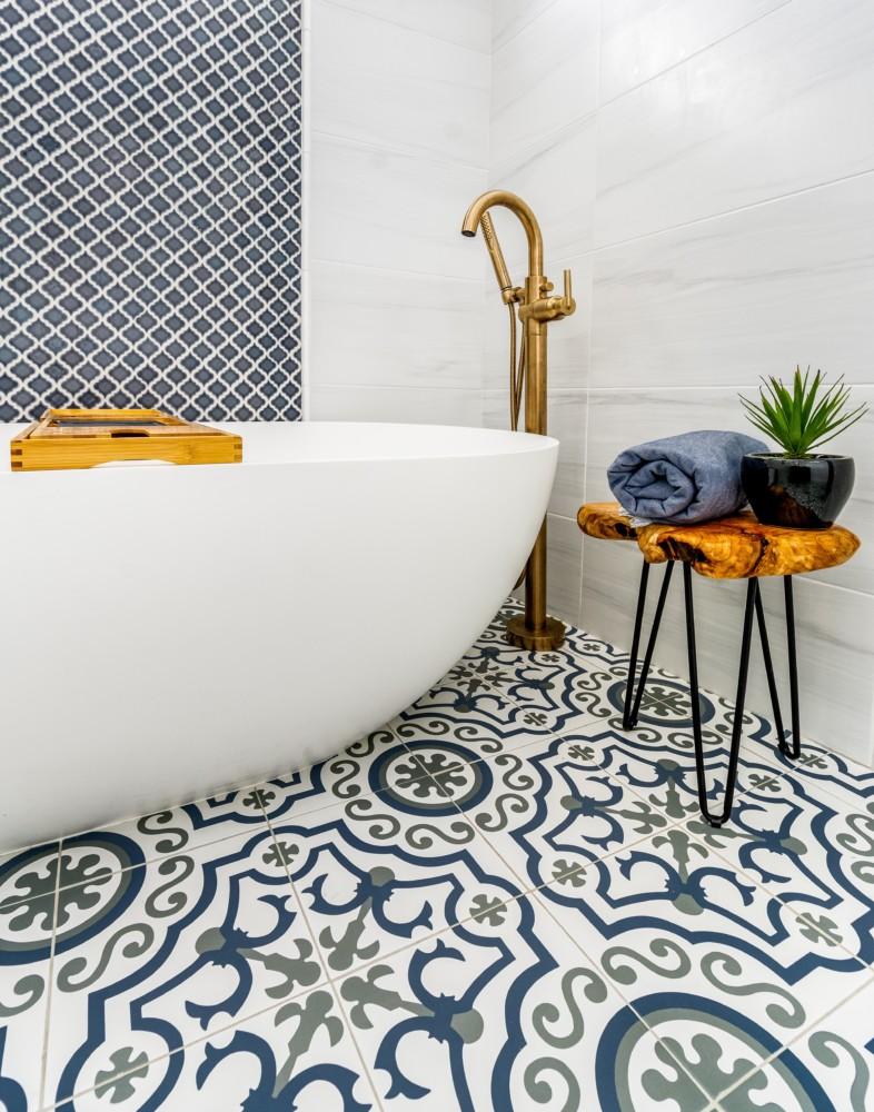 Painted floor tile Freestanding Oversized Tub with Matt Gold fixtures