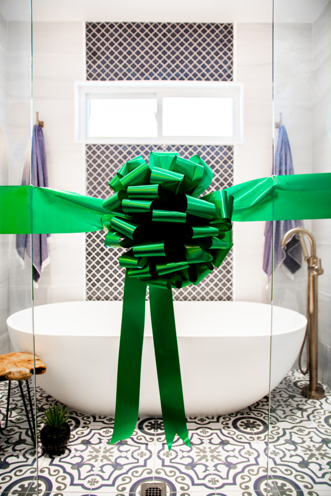 Ribbon Cutting of Custom Wet room with Oversized Tub and Dual Showerheads